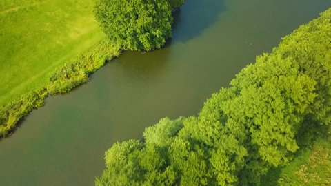 Aerial View of a river & lake in a forested region of British countryside