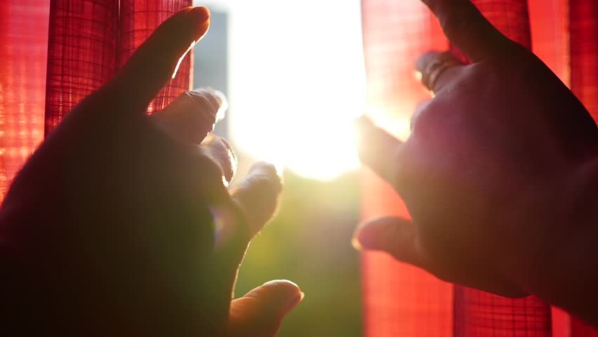 The girl opens red curtains and played with his hands through the sun's rays. Hand closeup | Shutterstock HD Video #30869386