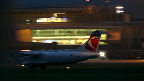 WARSAW, POLAND - SEPTEMBER 14, 2017. Czech Airlines ATR 72-500 commercial airplane landing the Chopin airport at night
