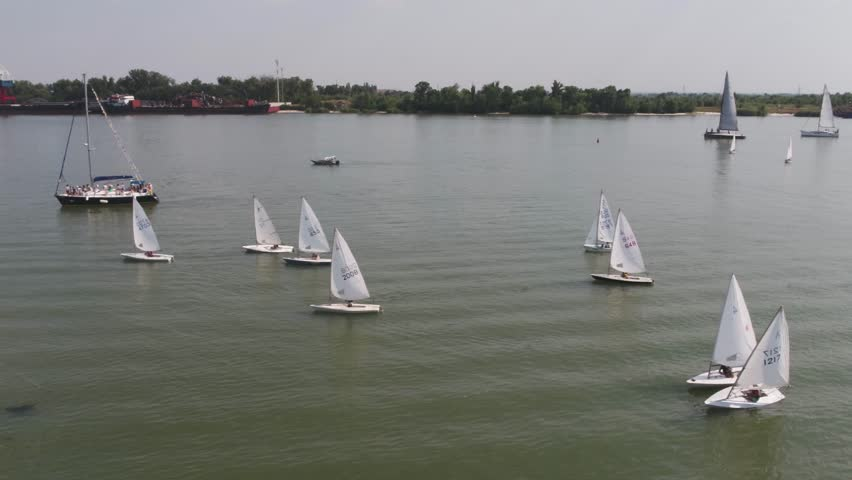 Sailboats floating on blue water of the lake. Competition sport of sailing.Yacht and beautiful seascapes
