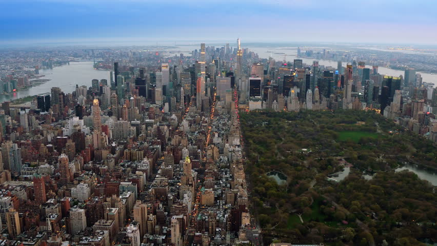 Beautiful aerial view of Central Park in Midtown Manhattan. Iconic skyscrapers as the Freedom Tower and the Empire State Building. New York City, United States. Shot from a helicopter.