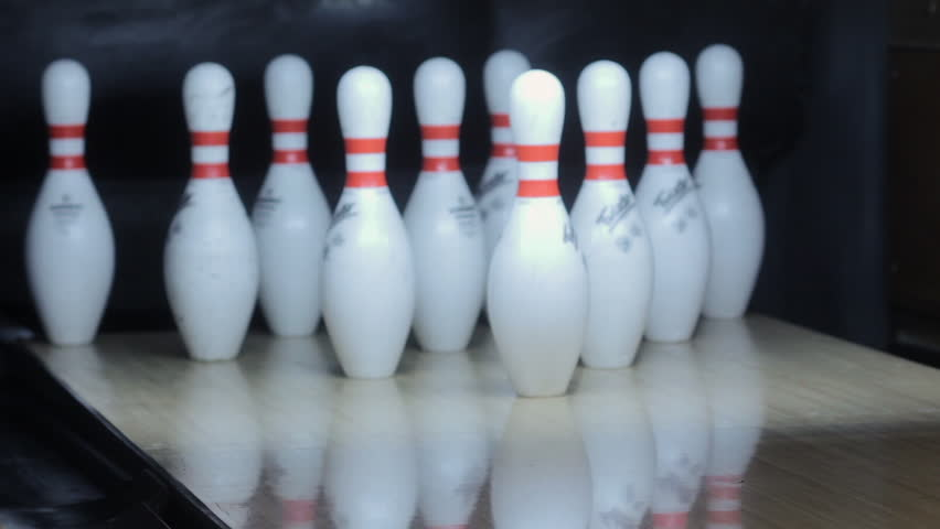 MINNEAPOLIOS, MN - AUG 25: Bowling game, ball knocking pins over for successful strike on August 25, 2017. About 70 million people in the United States bowl at least once each year.
