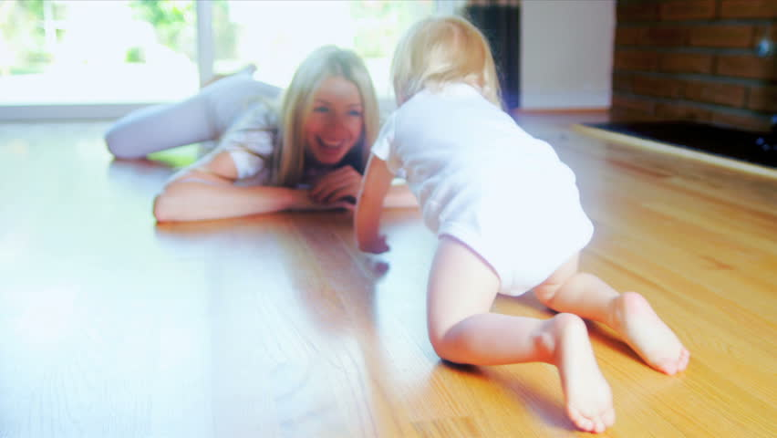 Smiling Baby Crawling Home Floor #3093952