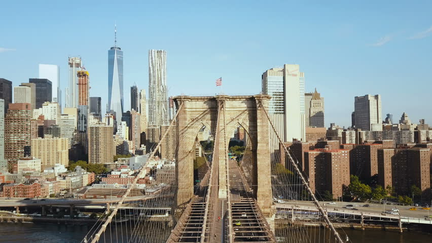 Aerial view of the Brooklyn bridge through the East river to Manhattan district in New York, America.