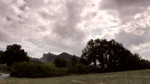 timelapse shot of view of countryside around fortress in Italy