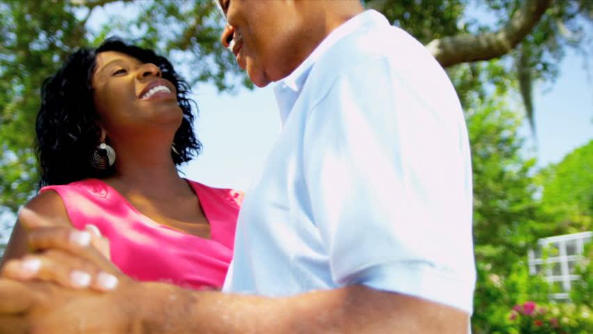 Contented Mature Ethnic Couple Advertising Retirement Living