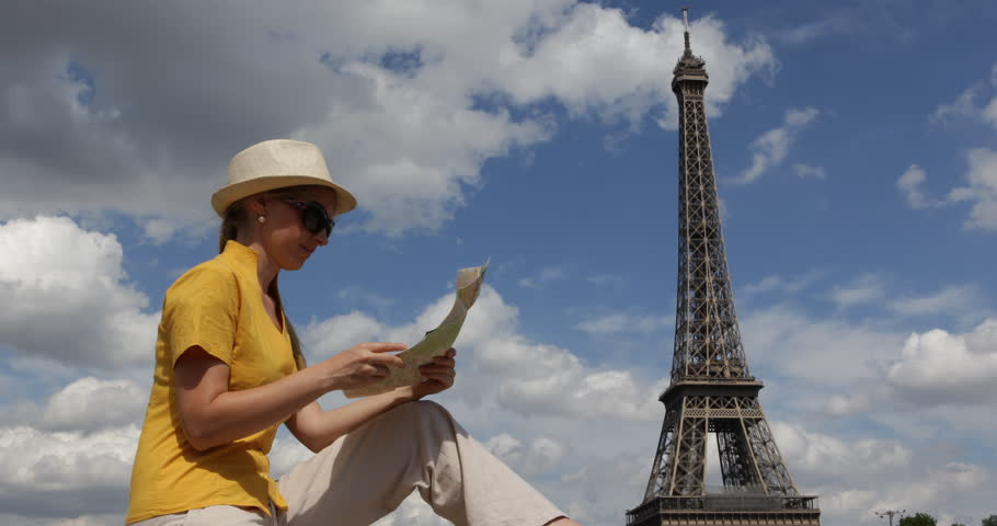 Pretty Tourist Woman Looking For Paris Tourism Attraction On City Map, Eiffel Tower | Shutterstock HD Video #30967585