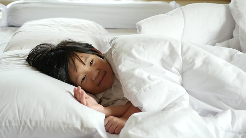Cute asian child sleeping on white bed slow motion | Shutterstock HD Video #30972481