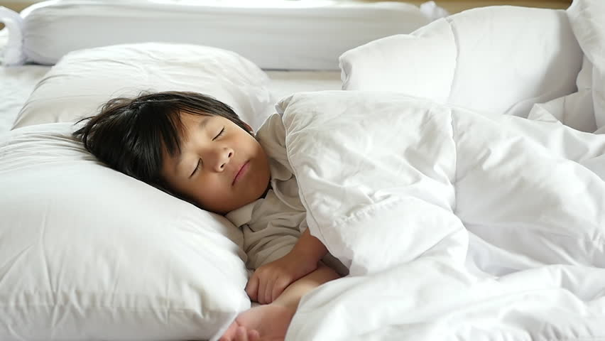 Cute asian child sleeping on white bed slow motion   Shutterstock HD Video #30972487
