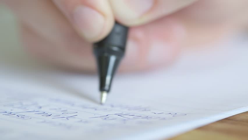 Extreme close up of a pen writing exam essay or letter, shallow depth of field. | Shutterstock HD Video #30983824