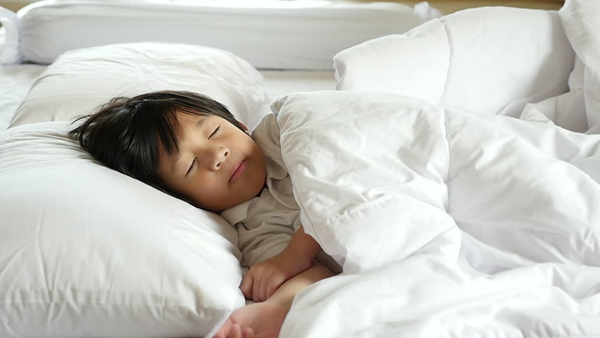 Cute Asian child sleeping on white bed with mother care slow motion   Shutterstock HD Video #30988531