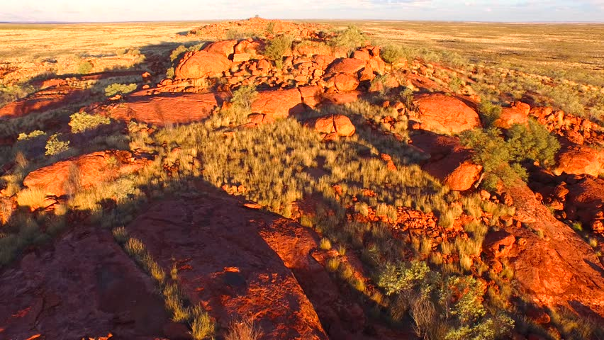 Rock formations during late afternoon sunlight in the Western Australian outback near the town of Newman.