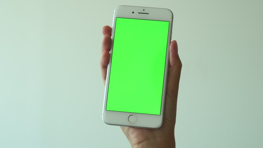 Bangkok, Thailand, SEP 22, 2017: white iphone 7 plus mobile phone. Smartphone on green screen display with chroma key editorial 4K