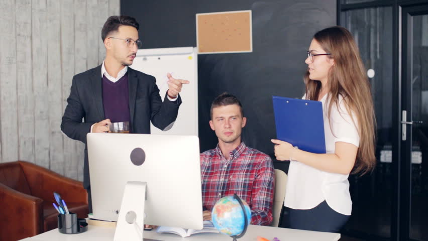 Business coworkers discussing new ideas and brainstorming in a modern office | Shutterstock HD Video #31001800