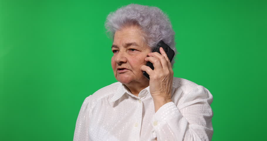Old Business Woman Talking to Mobile Phone Team Contact Green Screen Background   Shutterstock HD Video #31008862