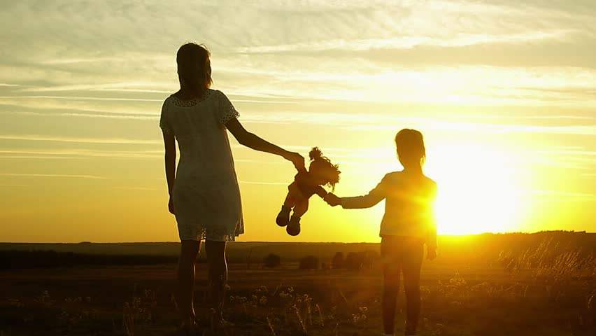 Silhouette of mom and daughter at sunset, holding toy doll and staring into the distance. Silhouette of girl play with dolls | Shutterstock HD Video #31020277
