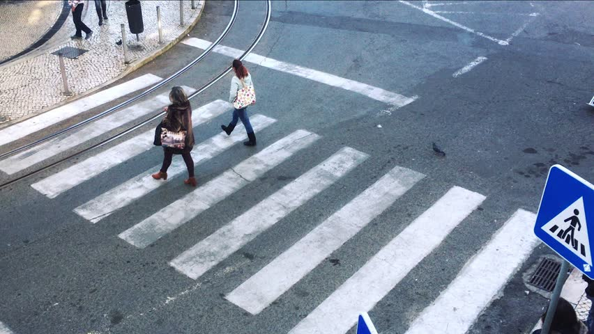 Pedestrian Crossing Time Lapse. LISBON, PORTUGAL - 21 JANUARY 2017; Time lapse of a pedestrians crossing on very busy street. High angle view | Shutterstock HD Video #31023103