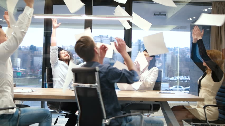 Trowing papers in air during meeting and celebrating new contract | Shutterstock HD Video #31024831