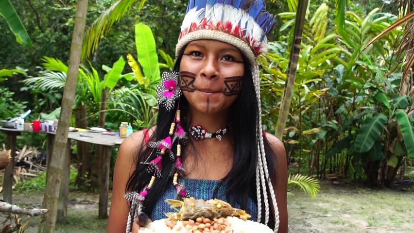 Native Brazilian Woman eating a traditional brazilian food