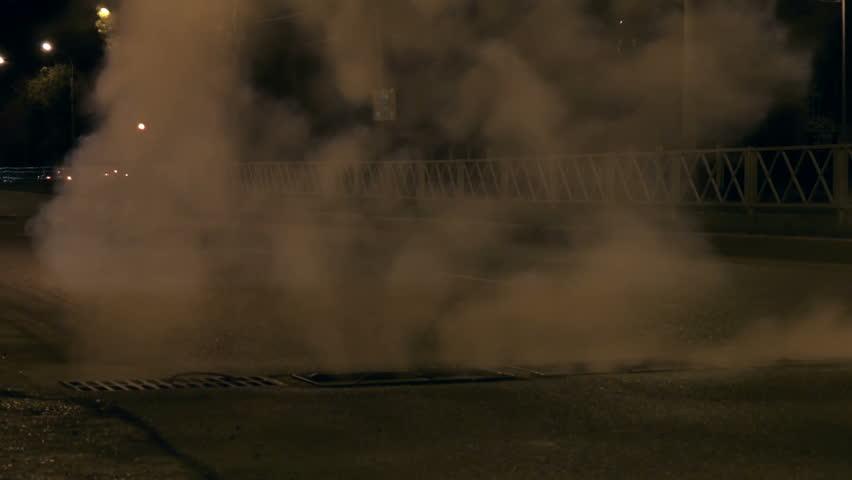 Steam from sewer manholes | Shutterstock HD Video #31037116