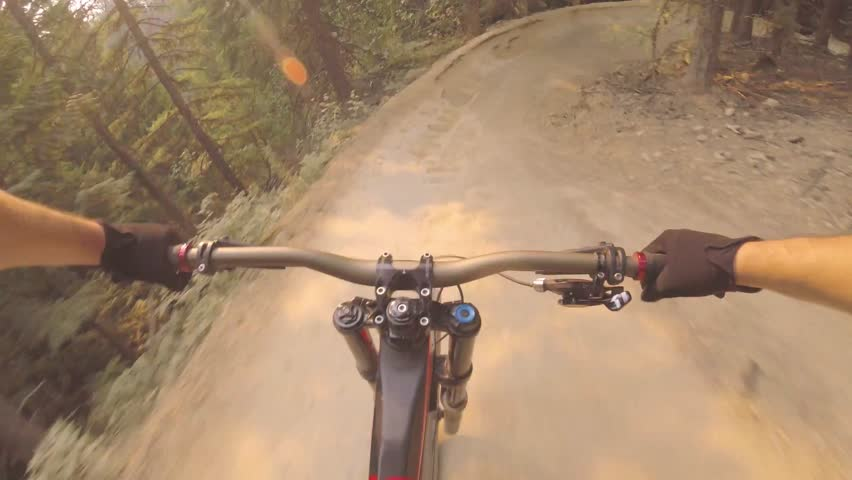 Male riding extreme sport mountain bike performing dangerous stunt on forest road in breathtaking 4k first person pov | Shutterstock HD Video #31037875