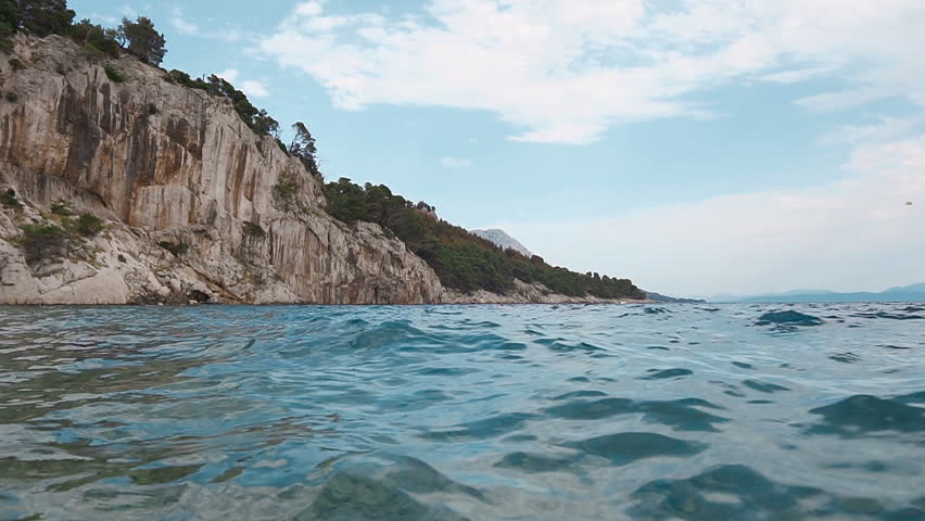 Light waves of white rocks in the Adriatic Sea. Dalmatia. Croatia SLOW MOTION