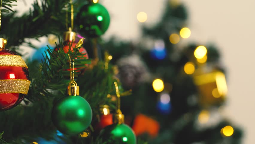 Greeting Season concept.Dolly of ornaments on a Christmas tree with decorative light and falling snow in 4k (UHD) | Shutterstock HD Video #31056328