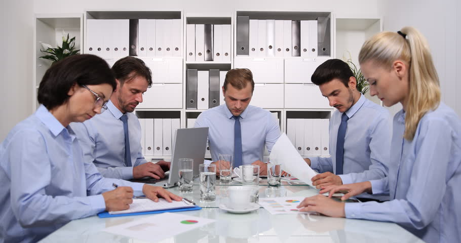 Busy Team of Business Staff Sitting on Conference Table Colleagues Work Strategy | Shutterstock HD Video #31056655