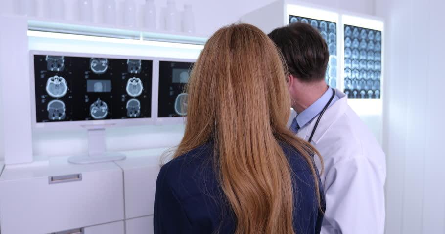 Senior Doctor Man Explain Patient Woman Positive Result on Brain MRI in Hospital | Shutterstock HD Video #31056691