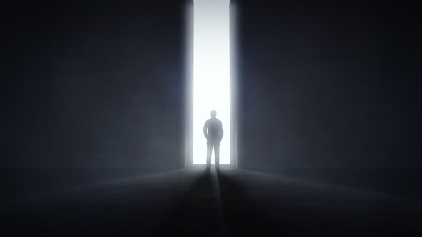 Man standing in the front of an opening light tunnel, opportunity concept