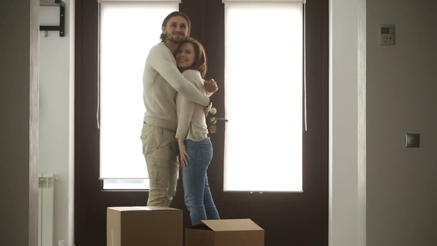 Happy family couple holding boxes opening door entering new luxury house, excited married property owners moving with belongings into own home, looking around rented bought residence and embracing #31060600