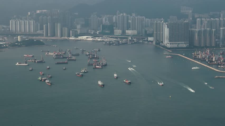 Hong Kong - Elevated view of Victoria Harbour with cargo ships. 4K resolution. September 2017   Shutterstock HD Video #31060906