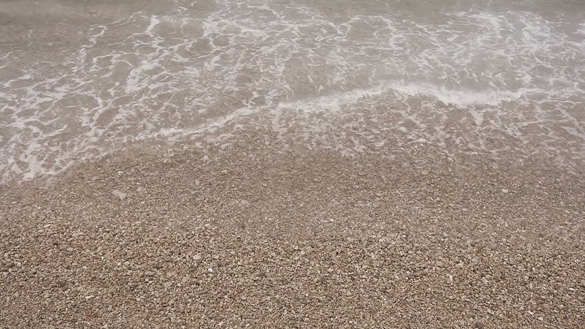 The soft wave of the Adriatic Sea on the pebble beach. Sea. Dalmatia. Croatia slow motion