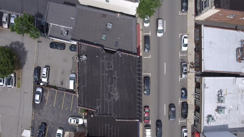 Drone hovers over the street following the rhythm of  typical urban town traffic,  | Shutterstock HD Video #31094809