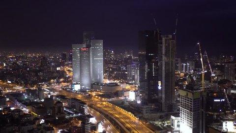 TEL AVIV, ISRAEL -  JUNE 10, 2017: Tel Aviv Skyline At Night Aerial View,  Ayalon Freeway Traffic Jam - Pan Left