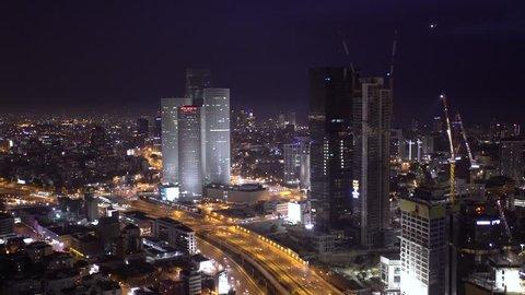 TEL AVIV, ISRAEL -  JUNE 10, 2017: Tel Aviv Skyline At Night Aerial View,  Ayalon Freeway Traffic Jam - Pan Right