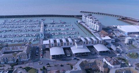Aerial dolly view of sailing boats in Brighton marina