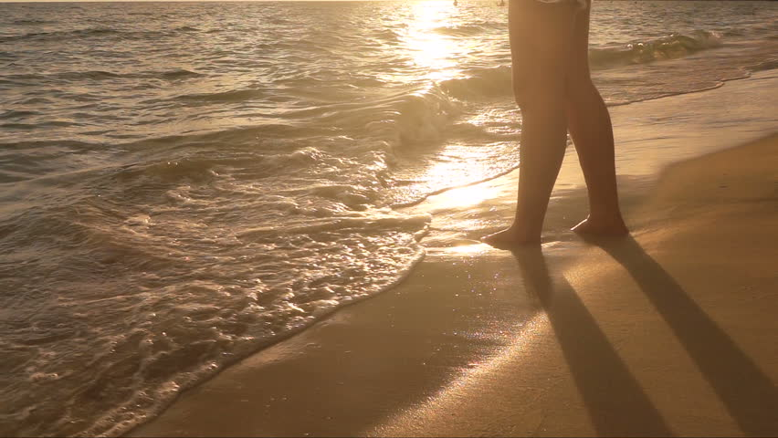 Slow notion : Woman leg at Sunset Beach with little sea wave  #31156132