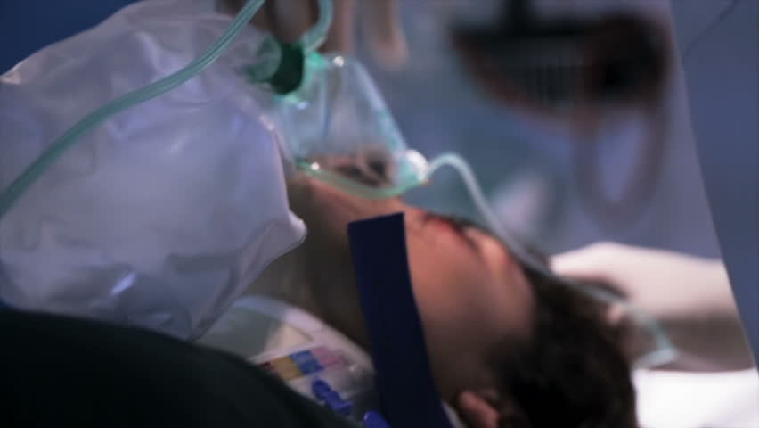 Medical crew removes ventilation mask of the dead patient