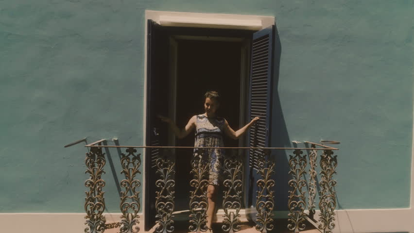 Young woman opens window on a beautiful blue balcony in a house on Ponza Island Italy | Shutterstock HD Video #31177633