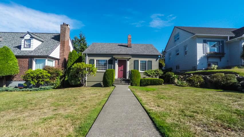 Small suburban home exterior approach; dolly shot