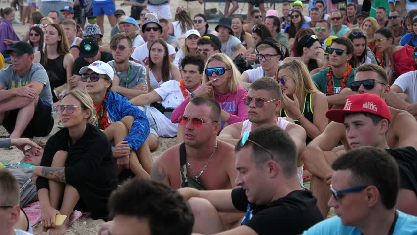 ZATOKA near ODESA, UKRAINE - AUG 24, 2017: Young People Crowd Sit On A Beach As Spectators Watch Some Event On A Sand | Shutterstock HD Video #31197958