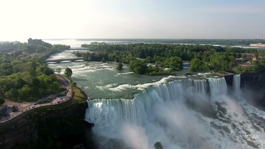 Spectacular flyover footage from the sky approaching, Niagara Falls from the most recognized and stunning view.
