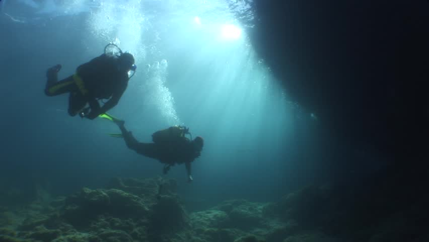 Scuba divers underwater with nice lightning scubadivers | Shutterstock HD Video #31204162