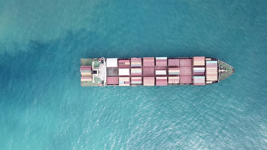 A container ship is entering the port loaded with containers and cargo - aerial 4k view #31205086