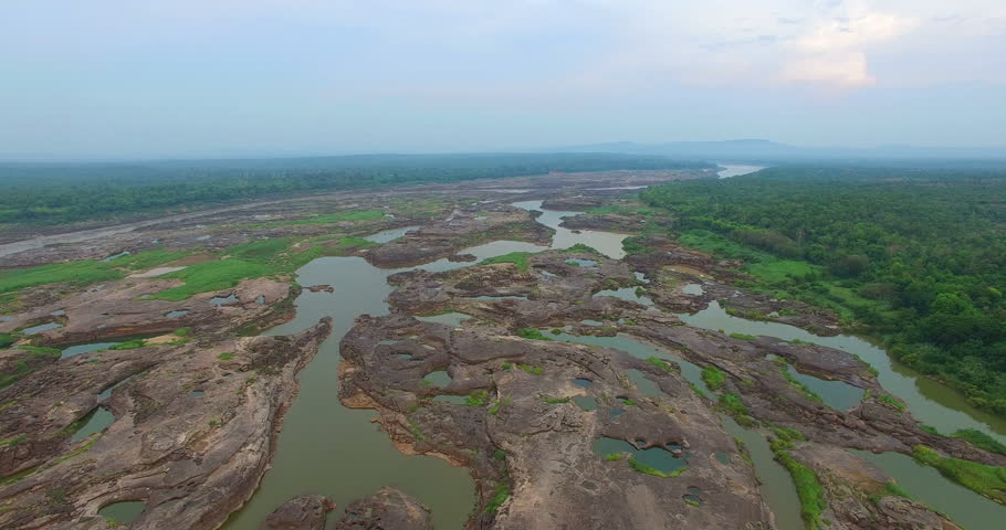 Aerial photography around grand canyon in Mekong river. 3000 bok mean 3000 holes,holes eroded into the rock along Mekong river. color of water inside the holes after low tide is emerald green