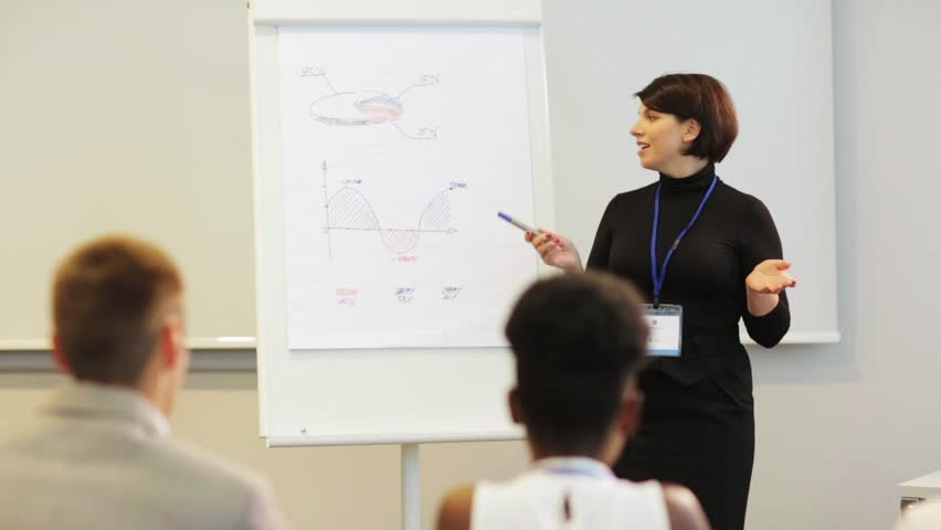 business, education and strategy concept - businesswoman showing charts on whiteboard to group of people at conference presentation #31241812