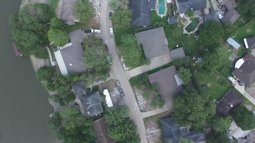 View over a neighborhood near Houston Texas that was flooded by Hurricane Harvey. Trash and debris outside of every home.