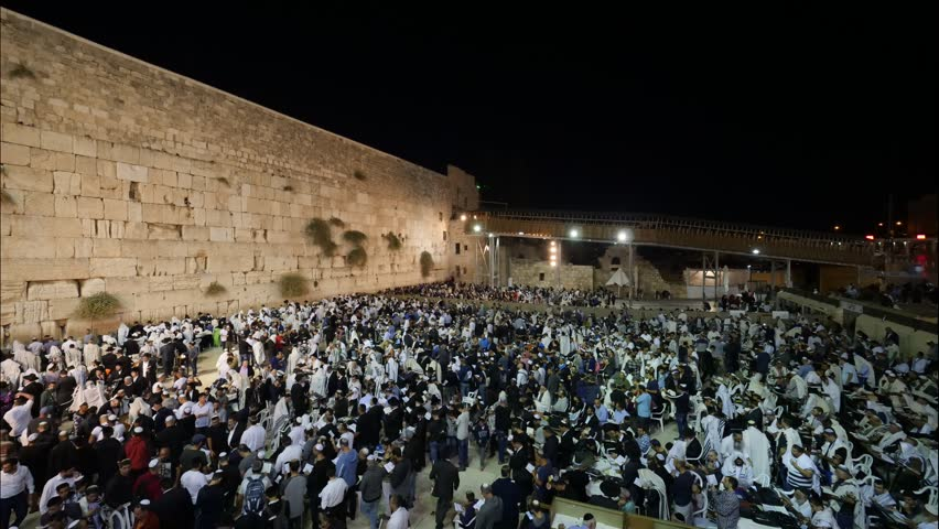 Timelapse - Sunrise at the prayer plaza wall in Jerusalem the western wall at Yom Kippur the day of Atonement, praying people asking for forgiveness