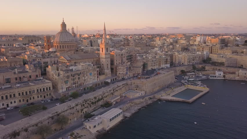 Dawn flying towards iconic Carmelite church dome and steeple in Valletta Malta | Shutterstock HD Video #31249162